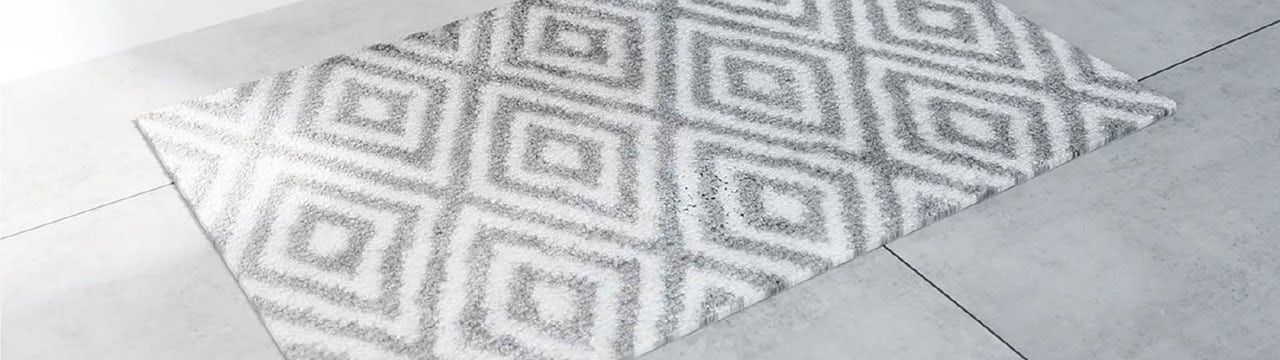How often should you wash your bath or shower mat?