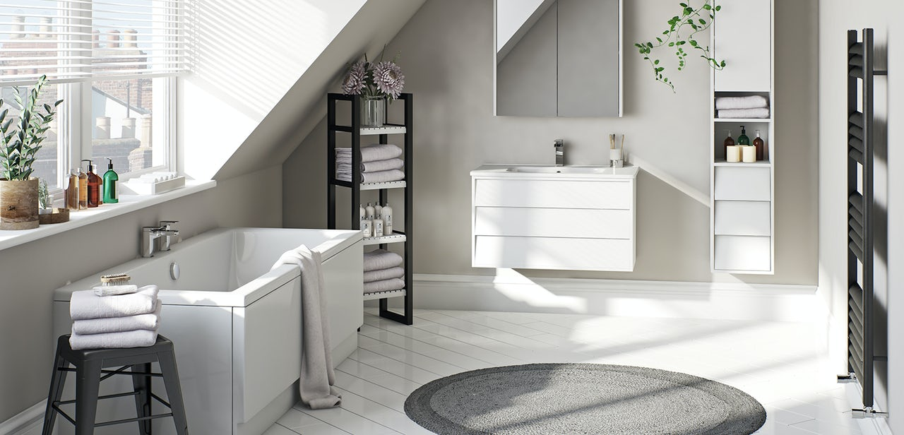 A Traditional Bathroom Set Up With White Vanity Unit And Tall Cupboards