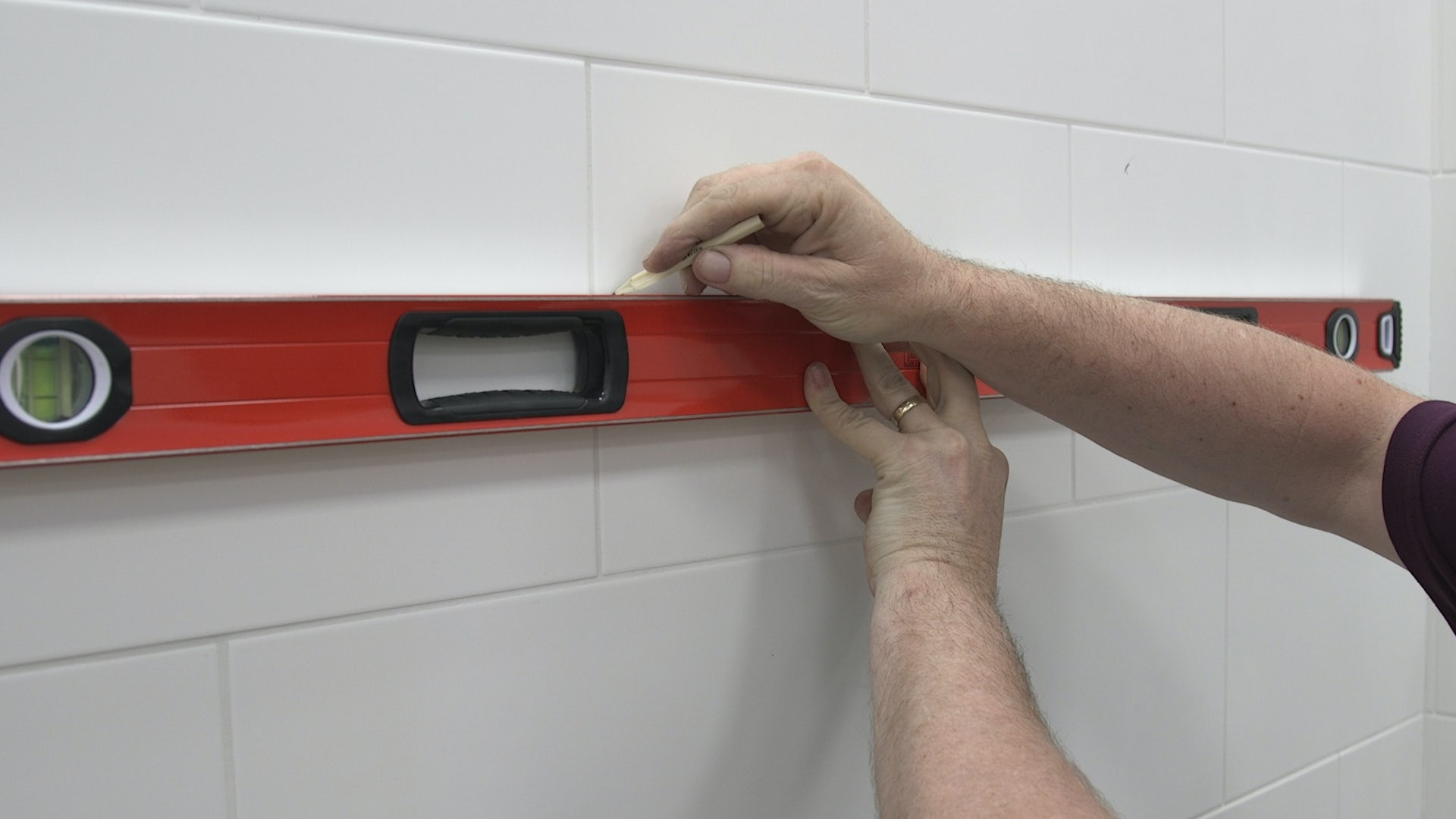Measuring and marking the distance between the bolt holes