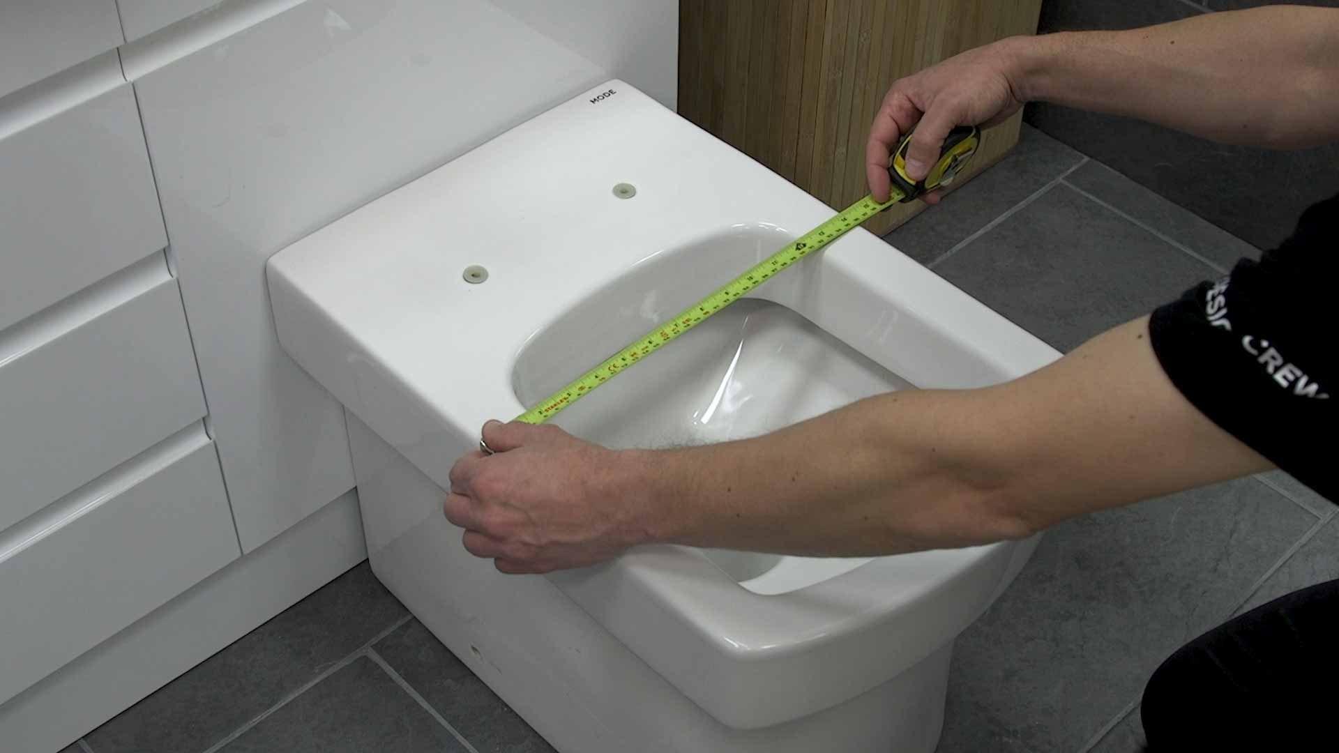 Measuring width of toilet