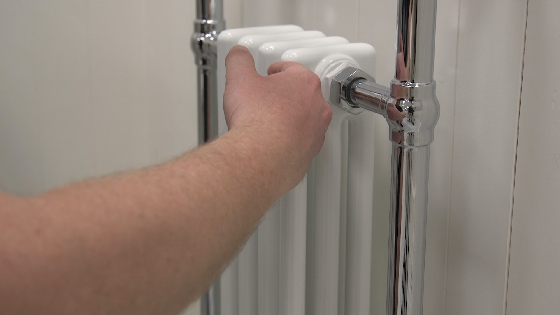 Check radiators or heated towel radiator for cold spots