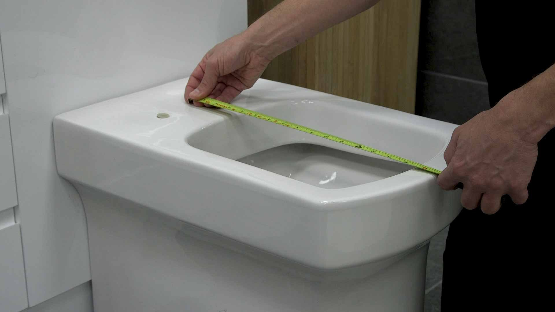 Measuring length of toilet