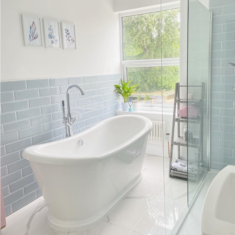 Soft neutrals bathroom with blue and white tiles