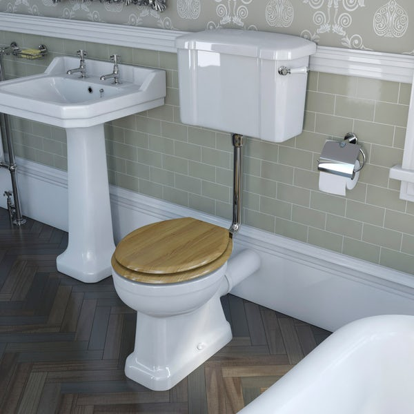 The Bath Co. Camberley low level toilet with wooden soft close seat oak effect and pan connector