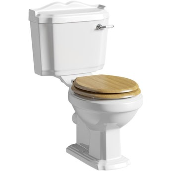 The Bath Co. Winchester close coupled toilet with oak effect soft close seat
