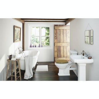 The Bath Co. Dulwich roll top bath suite with oak effect seat and taps