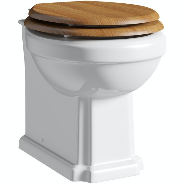 The Bath Co. Camberley back to wall toilet with oak effect soft close seat and concealed cistern