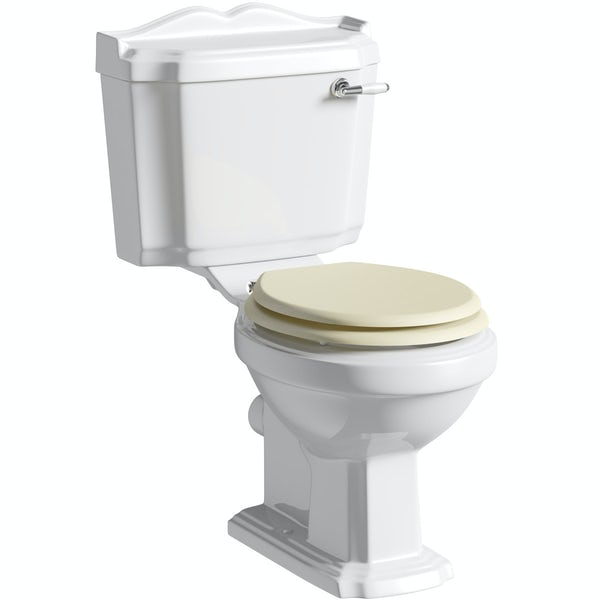 The Bath Co. Winchester close coupled toilet with ivory coloured soft close seat with pan connector