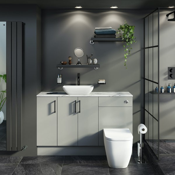 Reeves Wyatt light grey small fitted furniture combination with white marble worktop and countetop basin