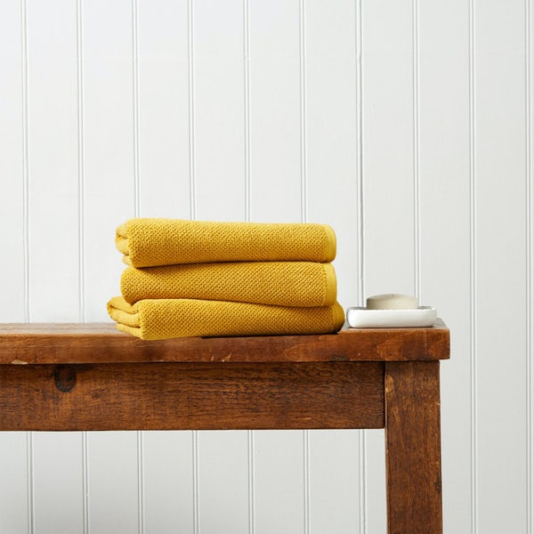 Christy Brixton saffron hand towel