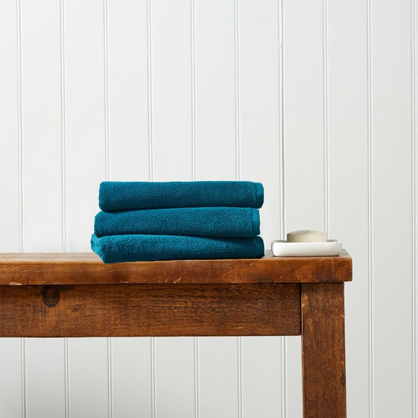 Christy Brixton peacock hand towel