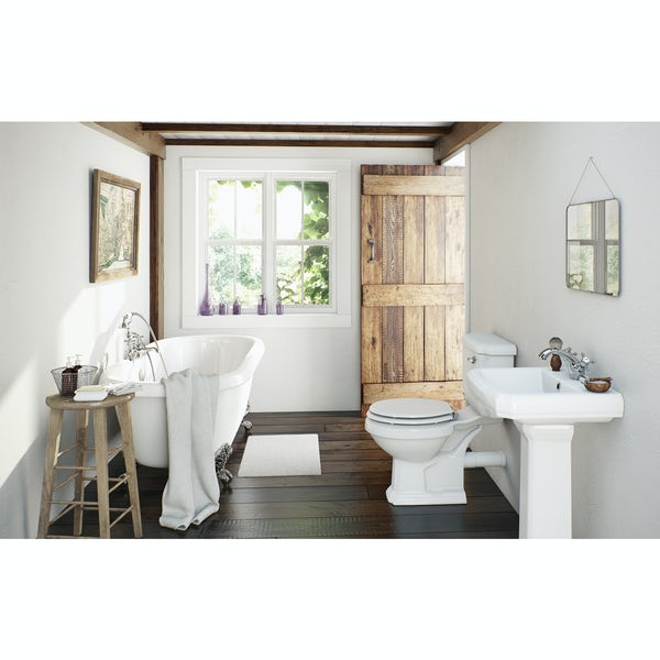 The Bath Co. Dulwich roll top bath suite with white seat and taps